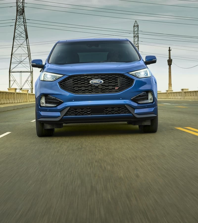 Head-on view of blue Ford car