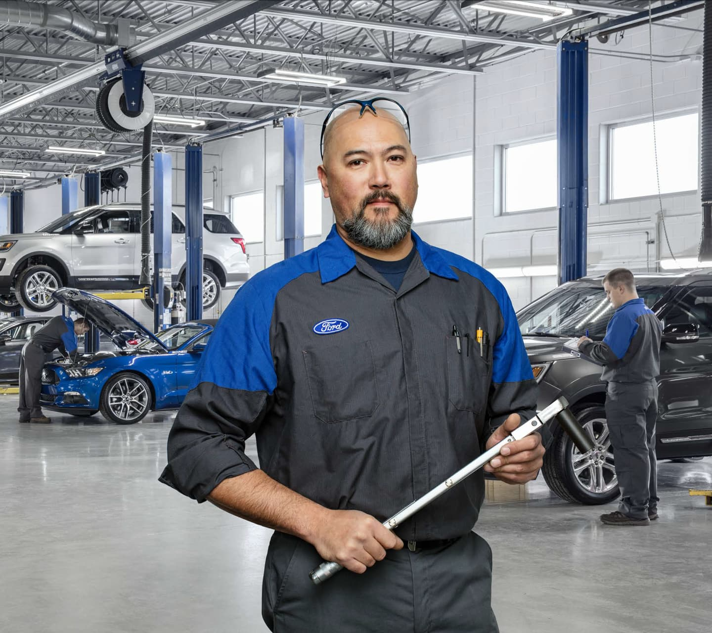 Mechanic holding a tool in the Ford Service Center