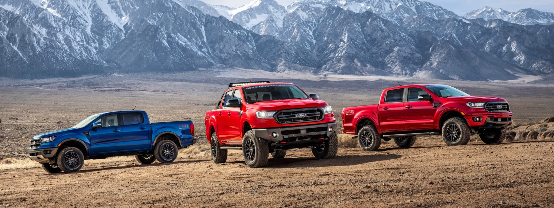 Ford Trucks with mountains in the background