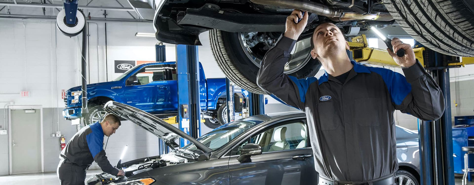 Mechanics working on Ford vehicles