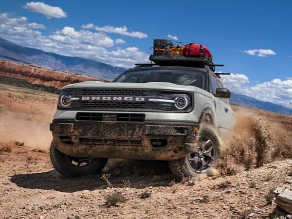 Ford Blue Bronco on top of some rocks