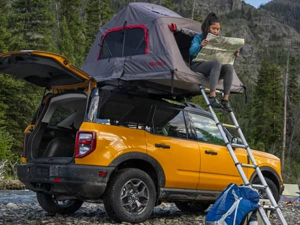 Ford Bronco Sport with camping tent attachment on the roof.