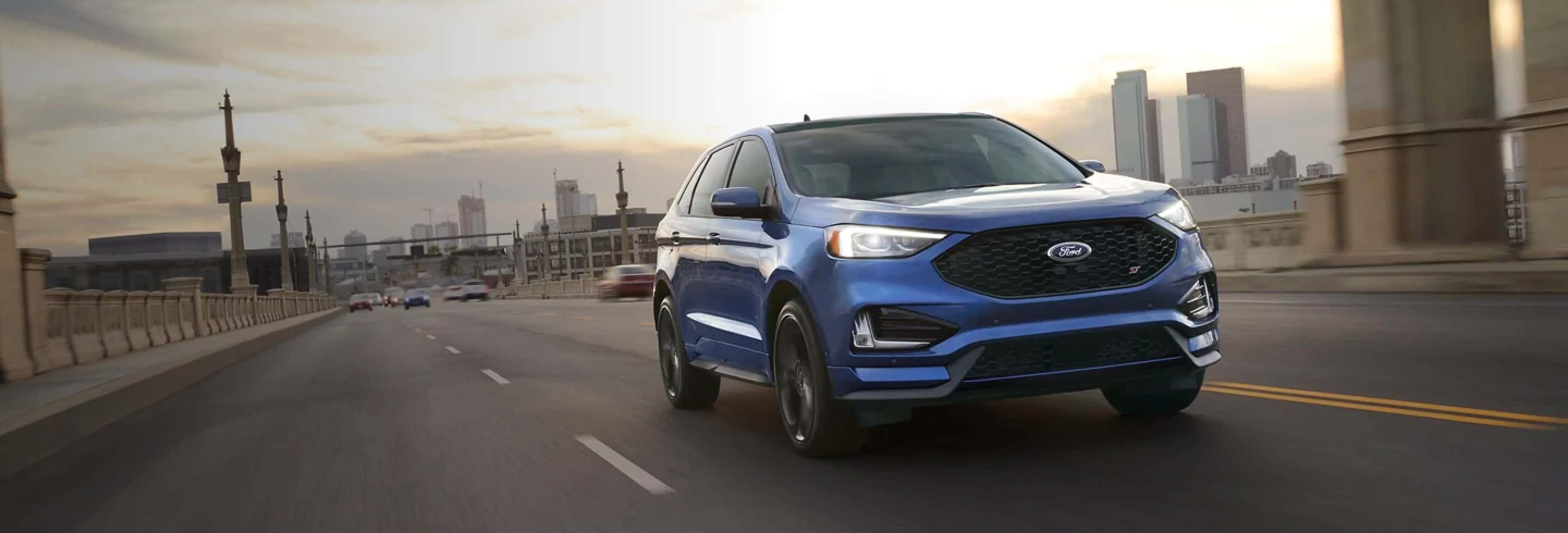 A Ford Edge driving on a street.