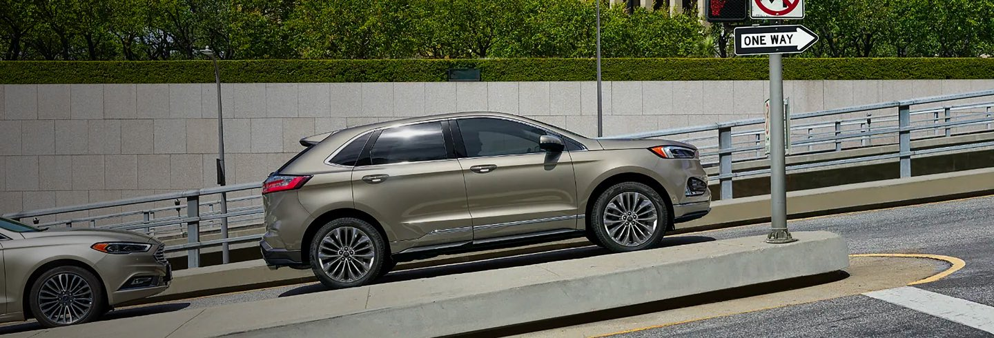 Ford Edge driving up an inclinded street