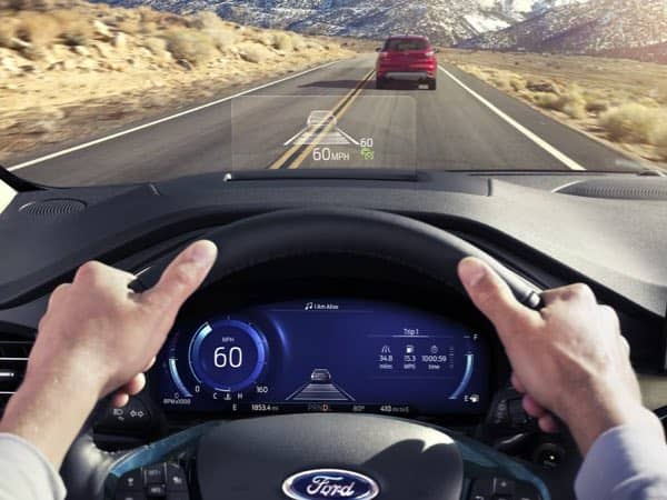 Driver of a Ford Escape using the head-up display
