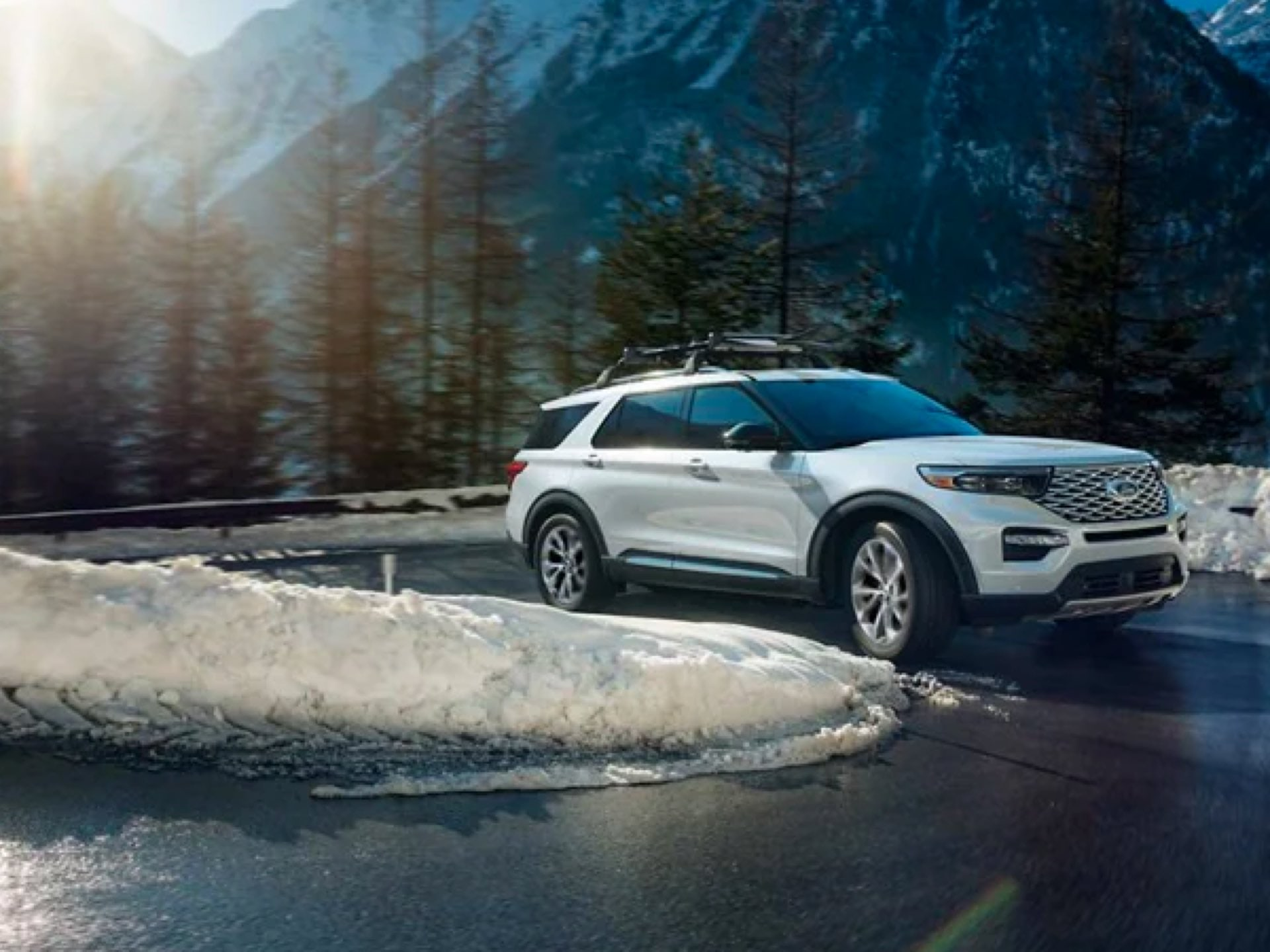 2021 Ford Explorer ST driving up a switchback mountain road