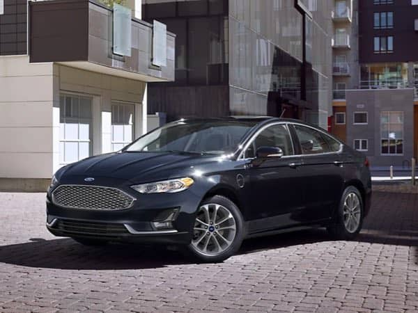 Blue Ford Fusion Hybrid parked at an angle