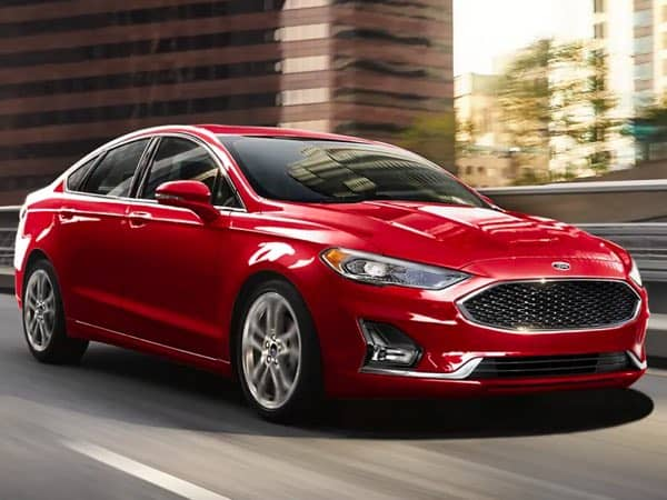 Red Ford Fusion Hybrid driving