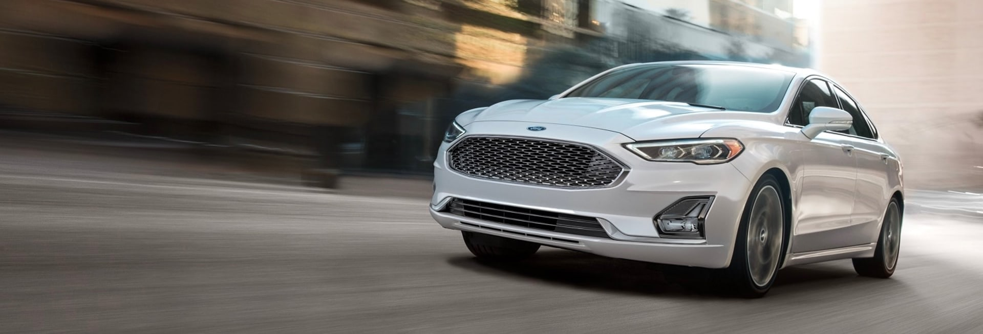 2020 Ford Fusion driving on a city street