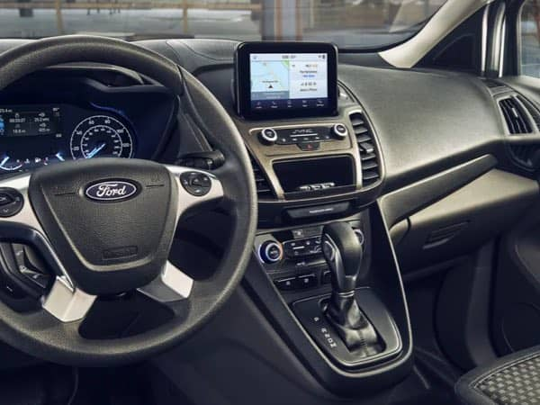 An interior shot of the Ford Transit Connect Cargo Van dashboard.