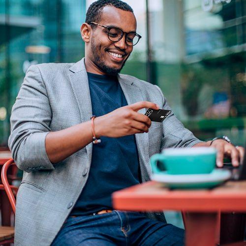 man looking at Credit Card