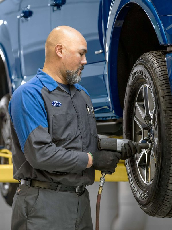 Ford tire getting serviced