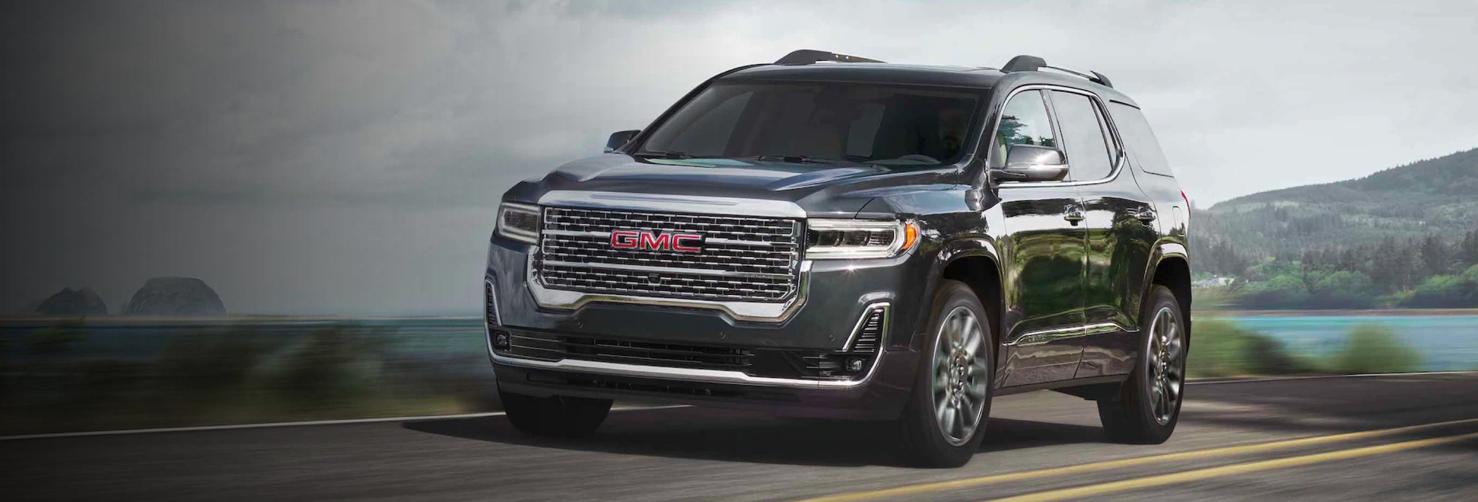 2021 GMC Acadia driving along country road
