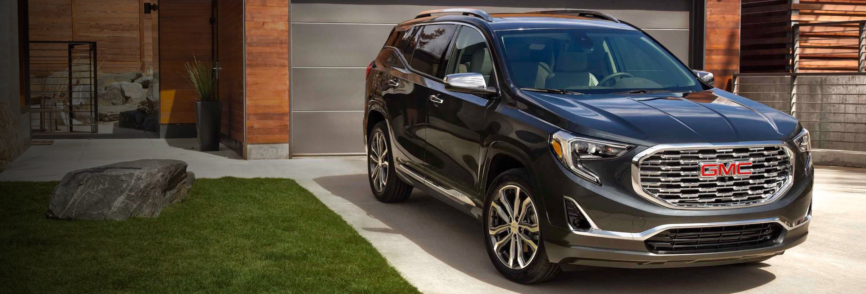 2021 GMC Terrain parked in driveway facing street