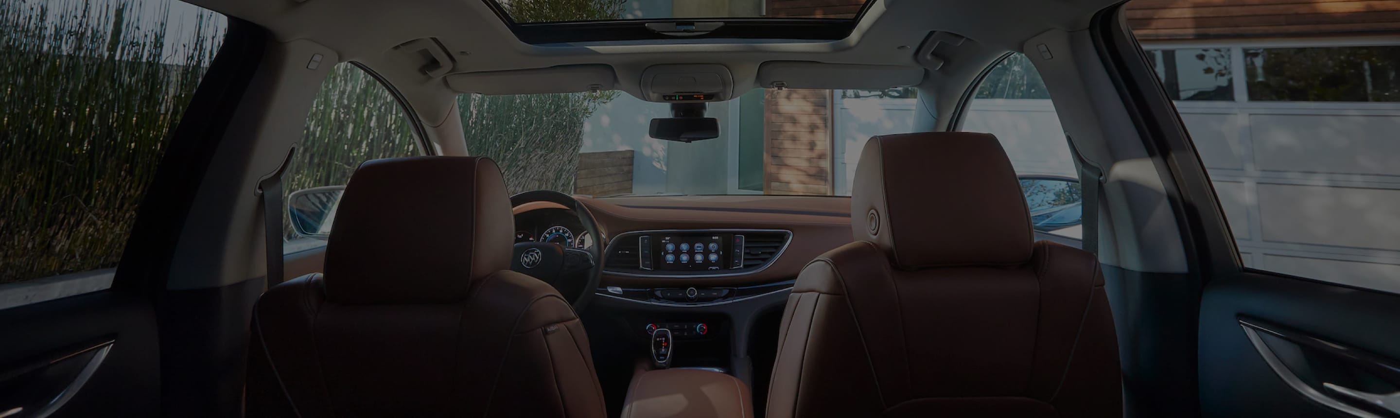 A front interior view of a Buick vehicle from the backseat
