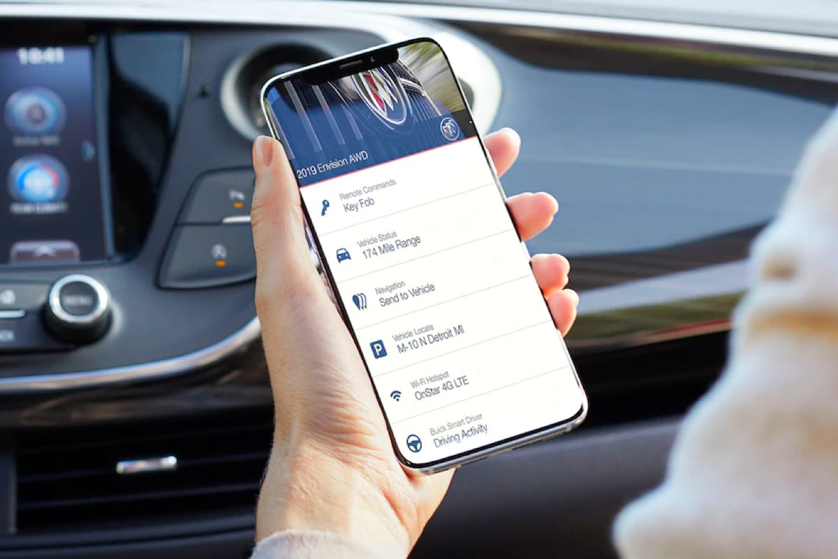 Buick, GMC mobile app on phone in user's hand