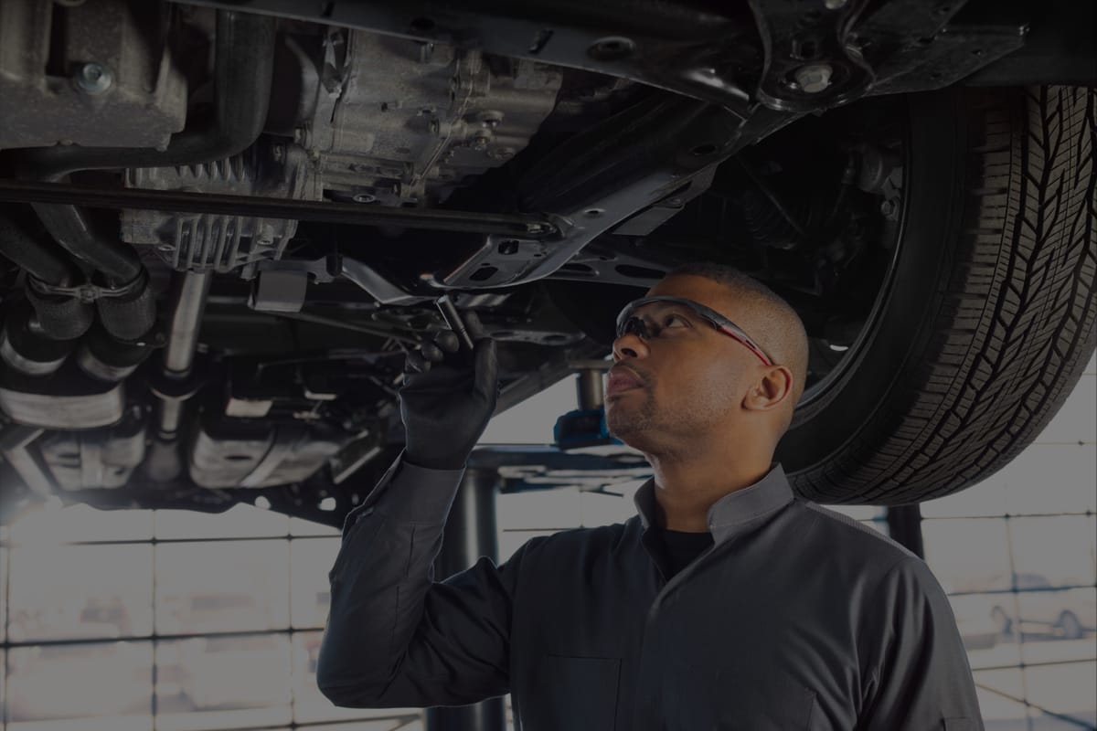 A service tech guy inspecting a vehicle