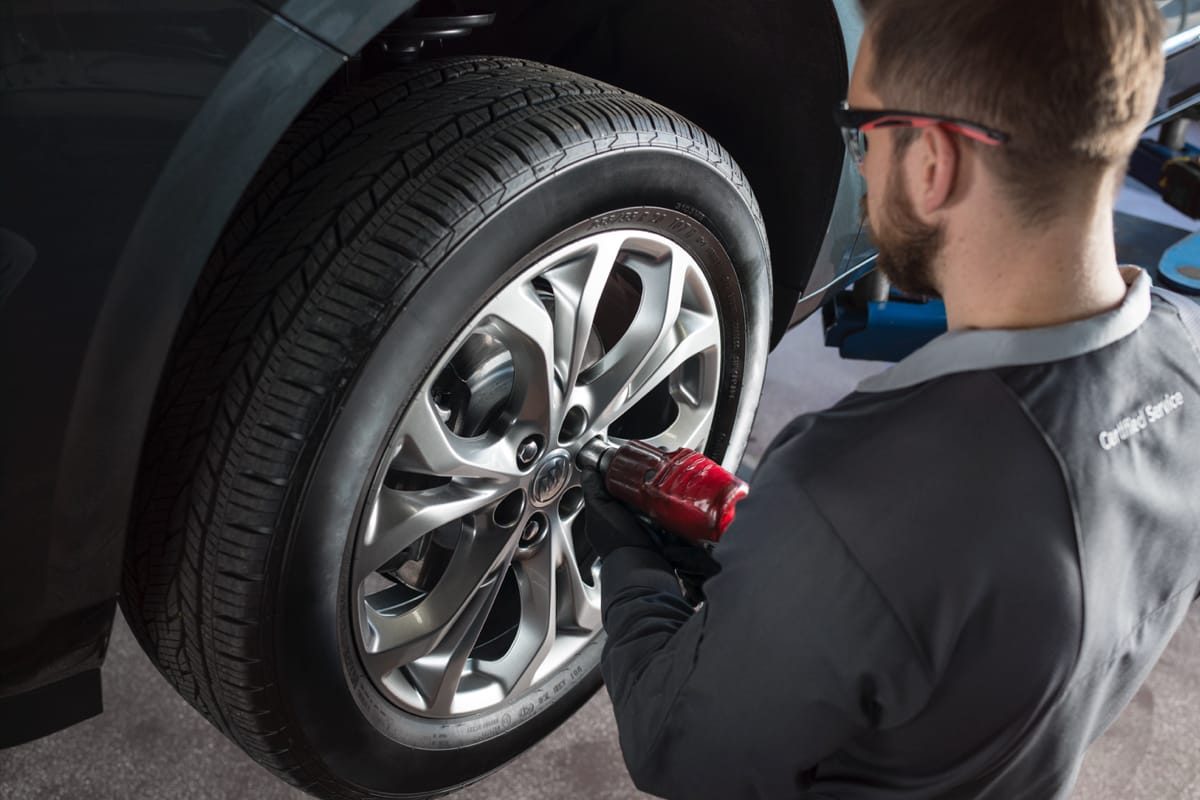 A service guy repairing and balancing a tire