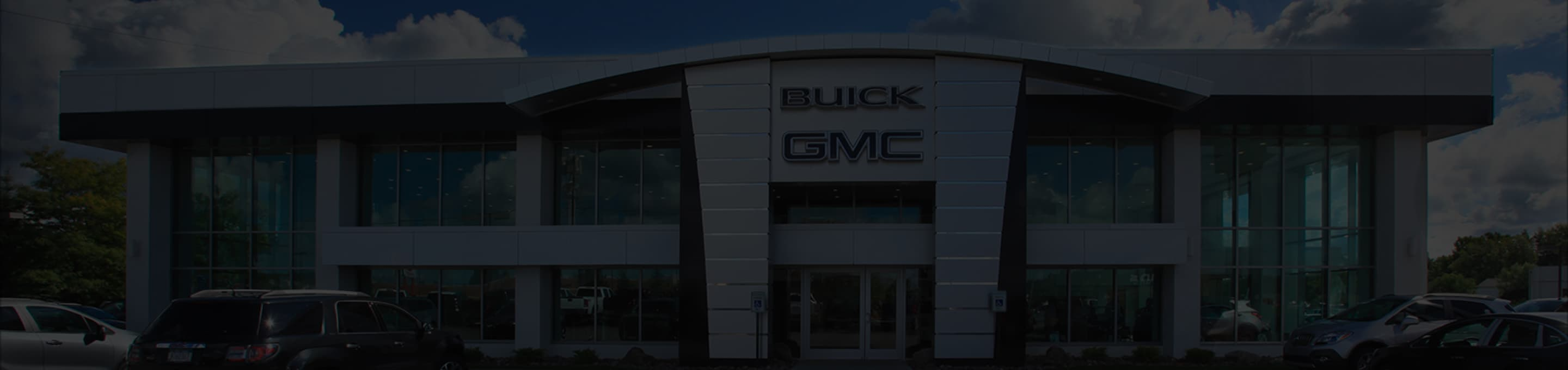 An exterior shot of a Buick/GMC dealership building