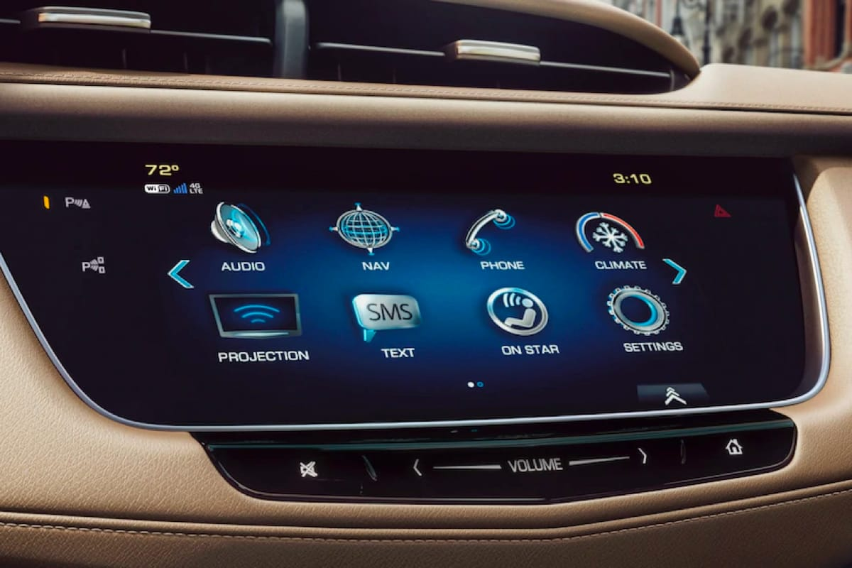 User interacting with vehicle touchscreen on dashboard