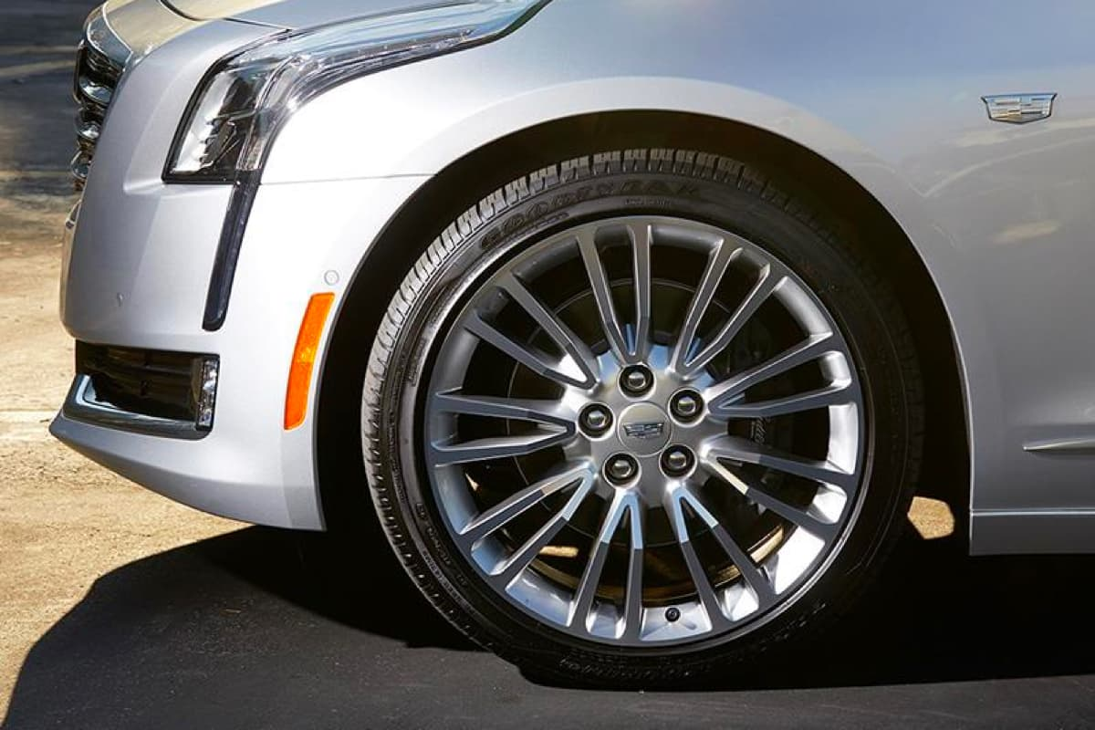 The left front tire of a Cadillac vehicle