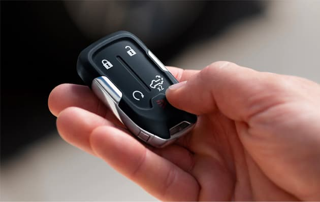 A shot of a person's hand holding a car key