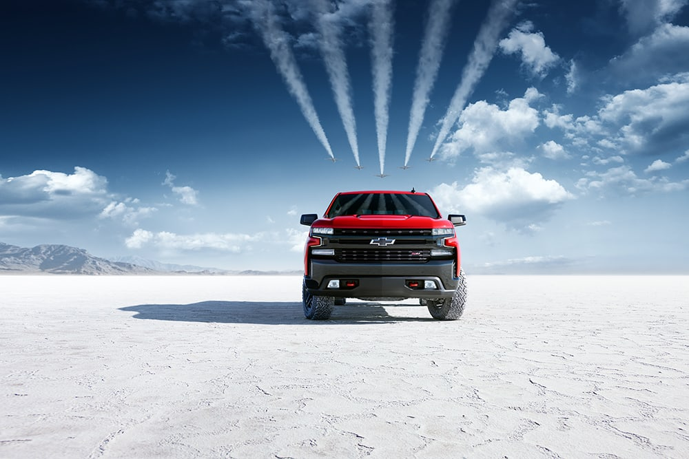 Military jets flying over a Chevy Silverado