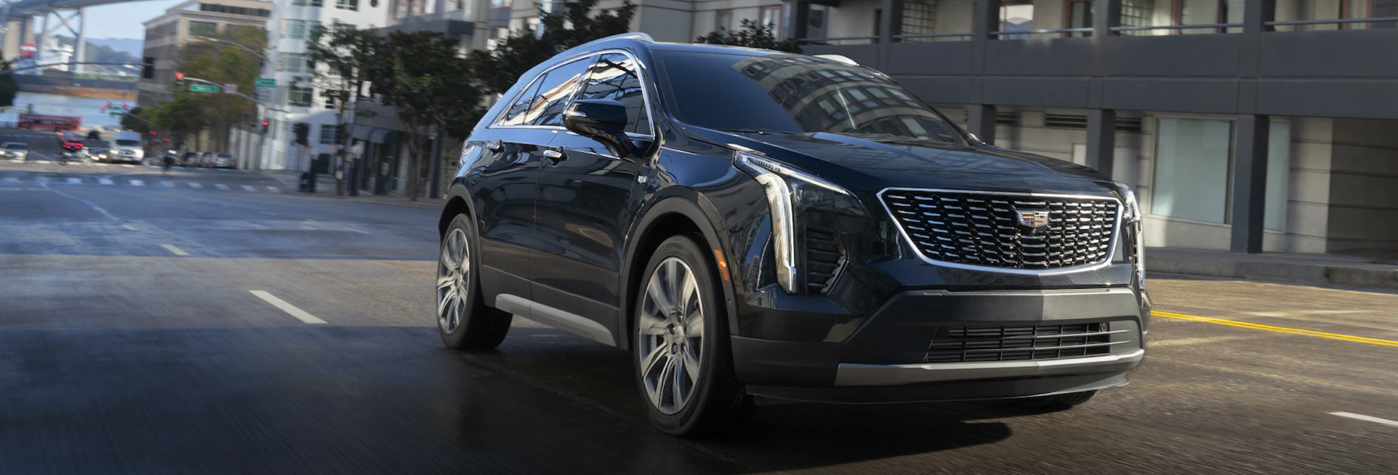 2021 Cadillac XT4 Driving Down City Street