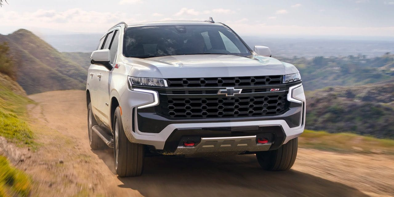 2021 Chevrolet Tahoe Front Elevated View of Tahoe driving on rugged terrain