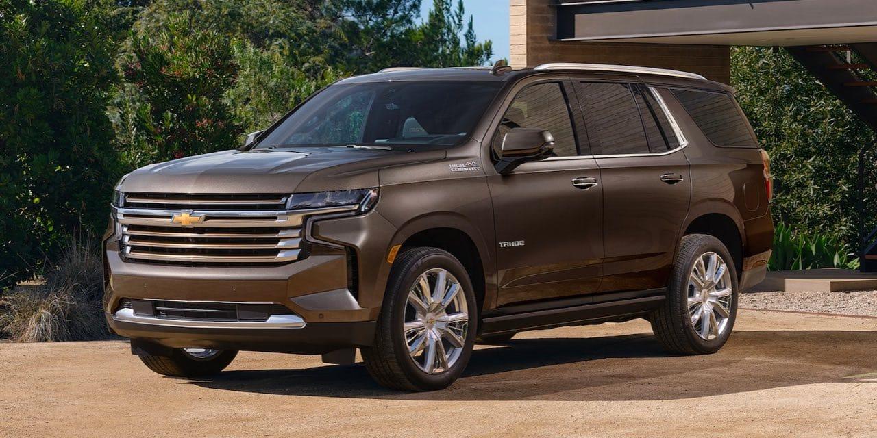 Parked front angled shot of 2021 Chevrolet Tahoe in a Driveway