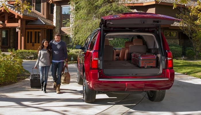 Couple loading their SUV for a trip