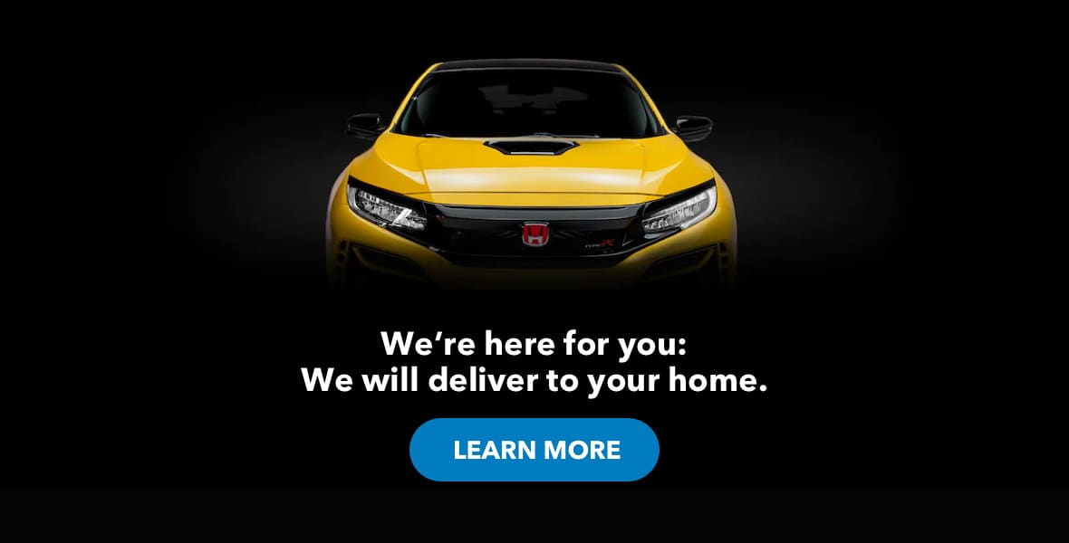 The front of a yellow Honda coupe.