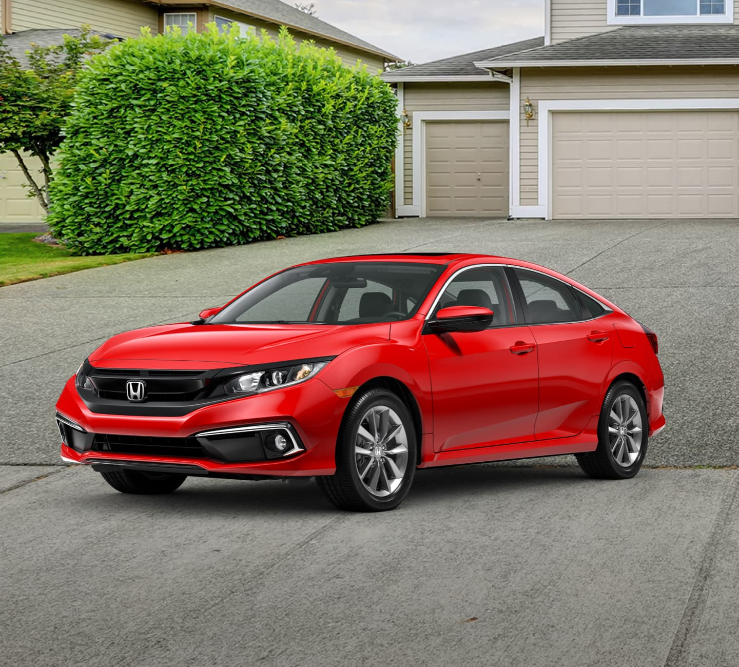 Red Honda parked in driveway