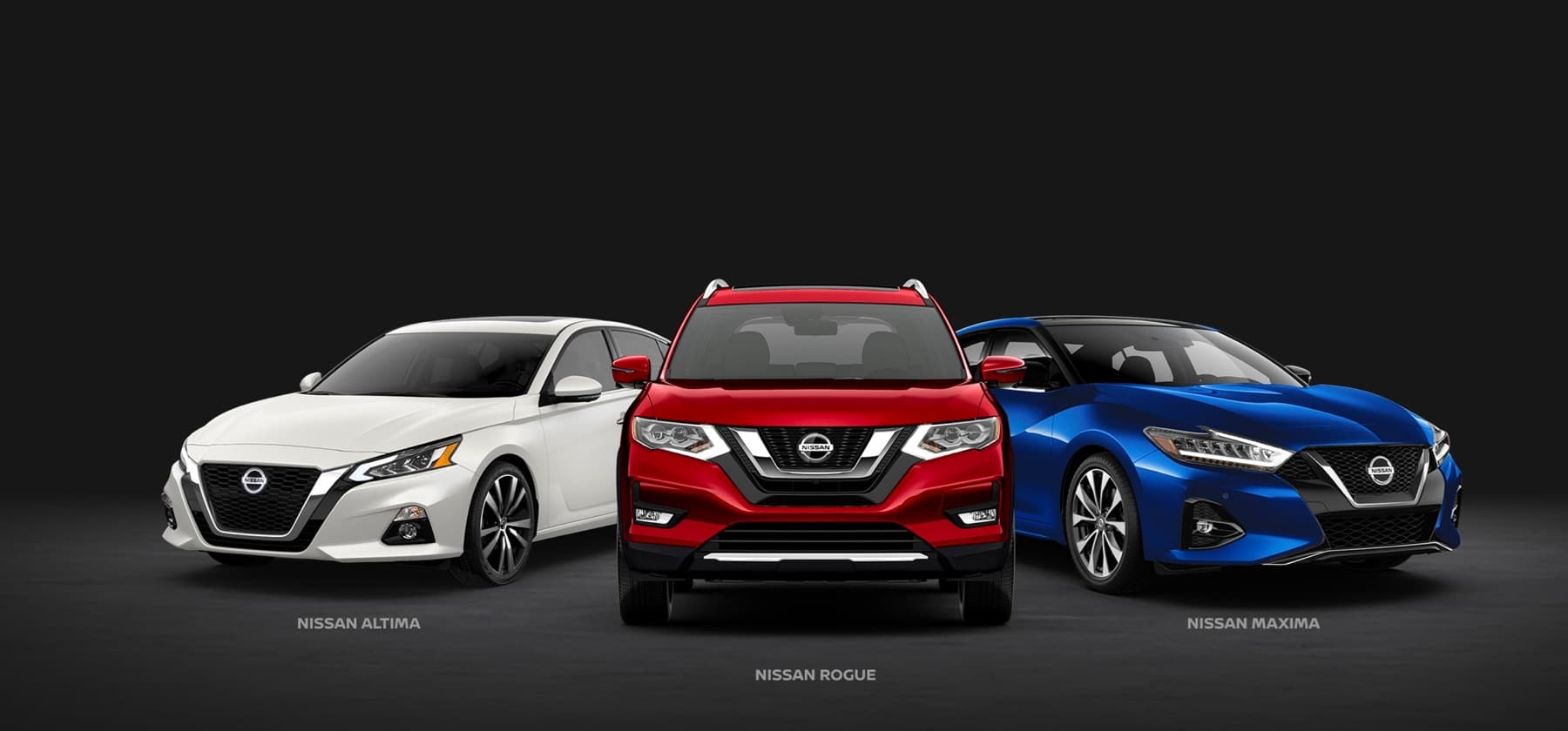 White Nissan Altima, red Nissan Rogue, blue Nissan Maxima