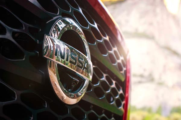 Front grille of Nissan vehicle with logo
