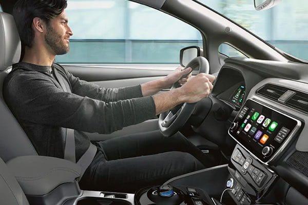 Guy driving Nissan LEAF