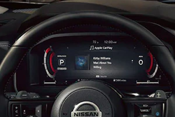 Close up of digital display behind steering wheel