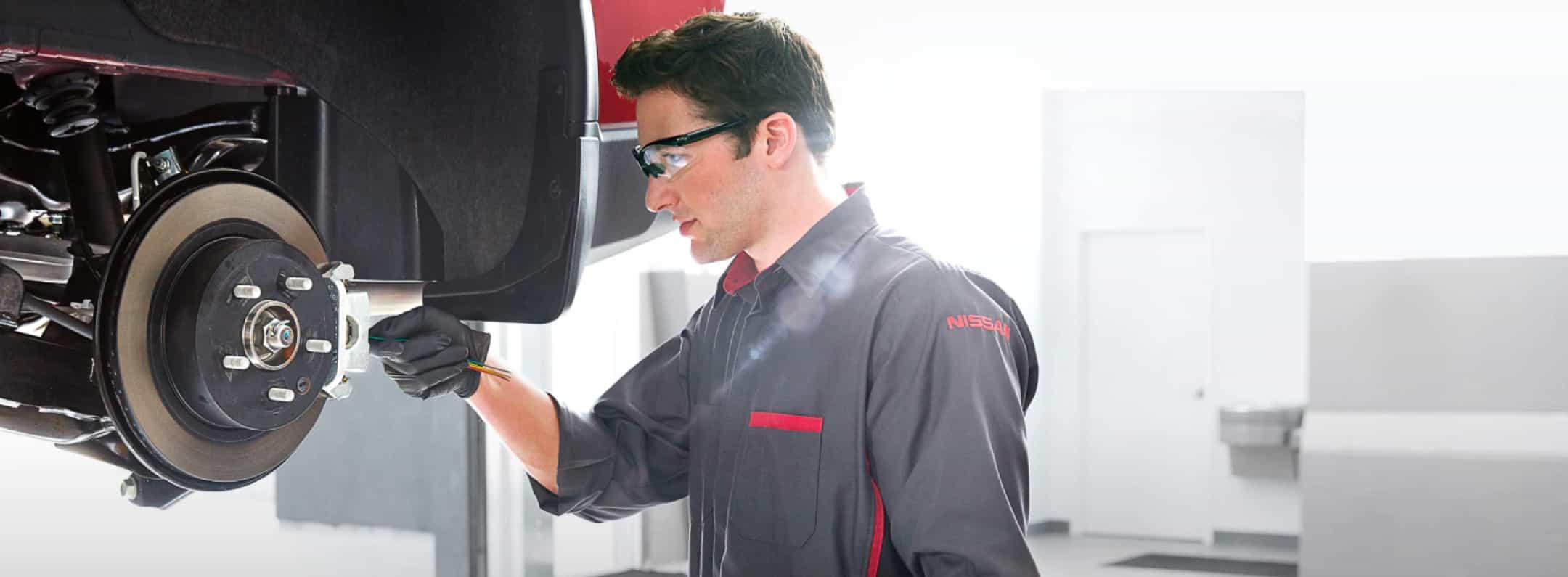 Mechanic checking vehicle breaks